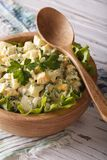 Egg salad with green onions and lettuce close-up vertical Stock Photo