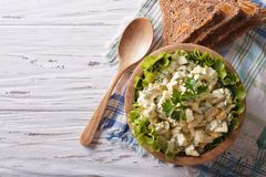 Egg salad with mayonnaise and bread horizontal top view Royalty Free Stock Photos
