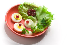 Egg salad on a red round dish. Over white background stock photo