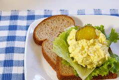 Egg Salad Sandwich. On whole grain bread with pickles Stock Photos