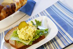 Egg Salad Sandwich. On whole grain bread with pickles Royalty Free Stock Photos