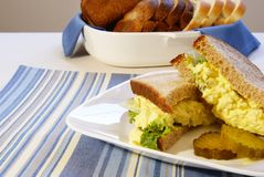 Egg Salad Sandwich. On whole grain bread with pickles Stock Images
