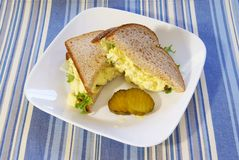 Egg Salad Sandwich. On whole grain bread with pickles Royalty Free Stock Photo