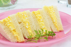 Egg salad sandwich. On white bread with a sprig of watercress Stock Image