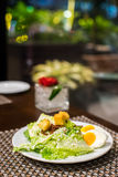 Egg salad. On the white plate Royalty Free Stock Photos