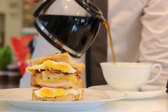 Egg sandwich and coffee Stock Images