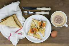 Egg sandwich with frothy cappuccino Royalty Free Stock Photos