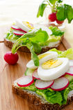 Egg sandwich on wooden table Stock Images