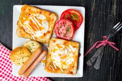 Egg sandwiches with tomato and sausage royalty free stock image