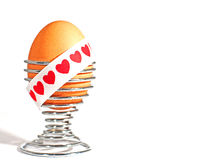 Egg & Sash. An egg with a love themed sash for use in Easter, Valentines or other Celebration based concepts stock photo