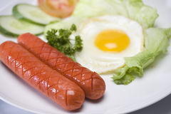 Egg and sausage Stock Images