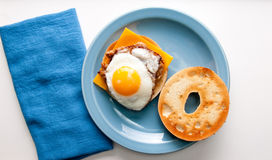 Egg with sausage patty on bagel Stock Photos