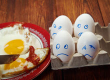 Egg with scared face and fried egg Royalty Free Stock Photos