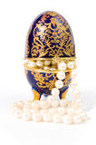 Egg shaped casket with a pearl necklace stock photo
