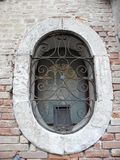 Egg-shaped window in Venice Stock Images