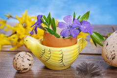 Egg shell with flowers in hen shape stand for easter Stock Photography