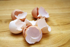 Egg shells. On wooden surface Royalty Free Stock Photography