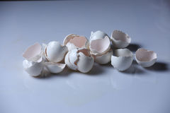 Egg shells. Broken egg shells on a white background stock image