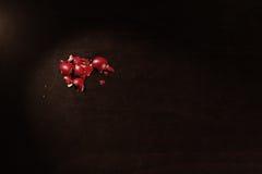 Egg shells. Cracked egg shells, red painted for Easter, black background stock image