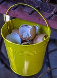 Egg shells for garden compost. Egg shells from a residential kitchen to be used for composting image in portrait format stock image