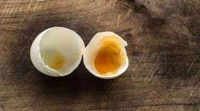 Egg shells. White egg shells on teak wooden stock image