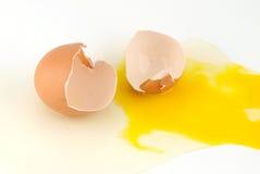 Egg shells and yolk on white Royalty Free Stock Image