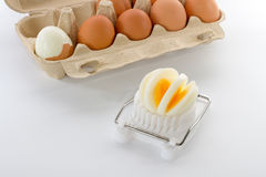 Egg slicer with a box of eggs Royalty Free Stock Image