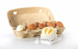 Egg slicer with a box of eggs Stock Images