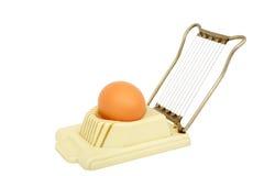 Egg slicer. Old egg slicer on a white background. Horizontal position stock photos