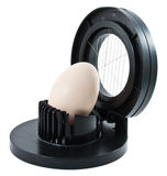 Egg slicer with one egg. On a white background Stock Photo