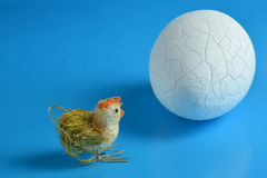 An egg with a small chick. Stock Photo
