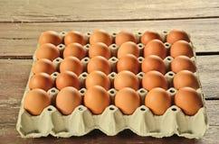 Egg in socket for sale. Plenty eggs in the brown paper socket Stock Image