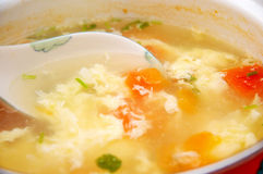 Egg soup with tomatoes Stock Photos