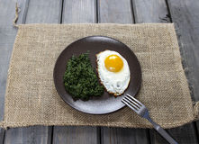 Egg with spinach  for healthy breakfast. Stock Photo