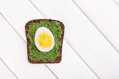 Egg and spinach toast on white Stock Image