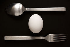 Egg, Spoon, And Fork Stock Image