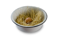 Egg in a strange nest. Egg lying in spaghetti arranged in a bowl Royalty Free Stock Photo