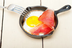 Egg sunny side up with italian speck ham Royalty Free Stock Image