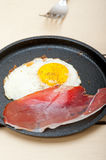 Egg sunny side up with italian speck ham Stock Image