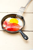 Egg sunny side up with italian speck ham Stock Photography