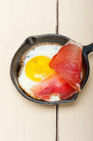 Egg sunny side up with italian speck ham Royalty Free Stock Photos