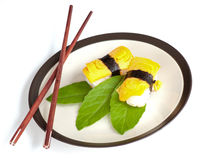 Egg sushi with chopsticks Stock Photo