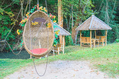 Egg swing in the park Royalty Free Stock Image