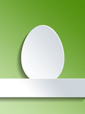 Egg symbol on white label over green Stock Photography