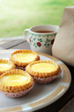 Egg Tart. An egg tart in dish on restaurant table stock images