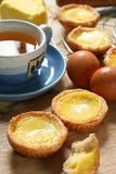 Egg tart. An chinese pastry case containing a filling of egg stock photos
