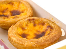 Egg tart. On paper box , isolated stock images