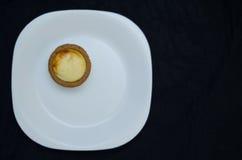 Egg Tart. An egg tart placed on white plate stock photos