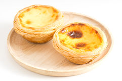 Egg tart in wood dish Stock Photography
