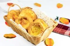 Egg Tarts in a basket Royalty Free Stock Photos